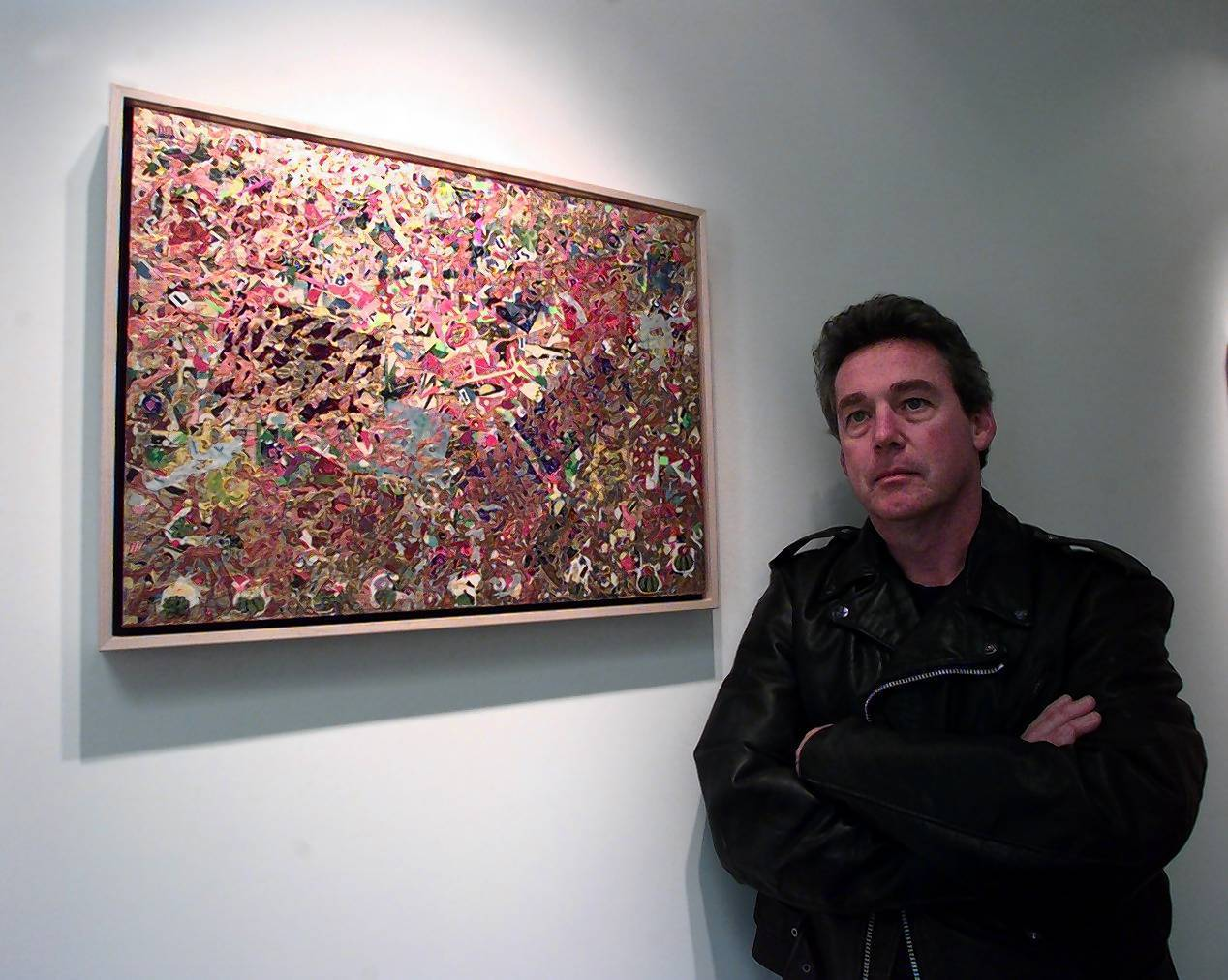 Artist Michael McManus is shown in 1997 in front of one of his paintings at the Peter Blake Gallery in Laguna Beach. McManus, the former chief curator for the Laguna Art Museum and organizer of a major scholarly overview of California Impressionism, has died at the age of 60.