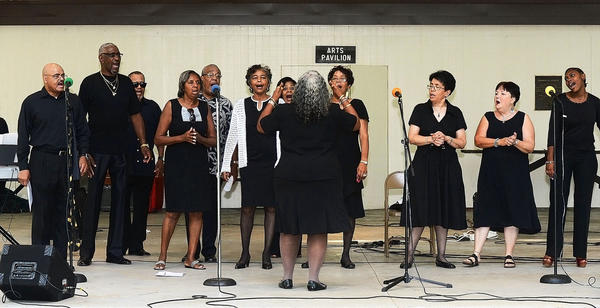 The Ebenezer AME Church Choir sings a gospel tune Sunday at Doubs Woods Park in Hagerstown. The performance was part of a gospel concert to raise money for the Contemporary School of the Arts & Gallery Inc.