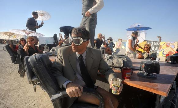 "A ""Mobile Board Room"" moves along the playa at the Burning Man festival."
