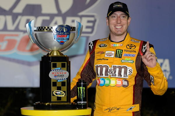 Kyle Busch, driver of the #18 M&M's Toyota, celebrates in victory lane after winning the NASCAR Sprint Cup Series AdvoCare 500 at Atlanta Motor Speedway on September 1, 2013 in Hampton, Ga.