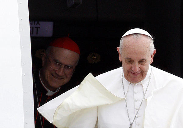 Cardinal Tarcisio Bertone, left, joins Pope Francis in disembarking from the papal plane last month in Rio de Janeiro. Bertone was replaced last week as the Vatican's secretary of state.
