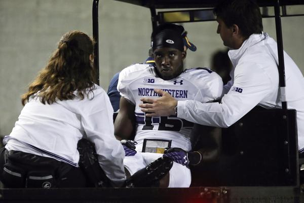 Northwestern cornerback Daniel Jones is carted off the field during the second quarter against the California Golden Bears at Memorial Stadium.