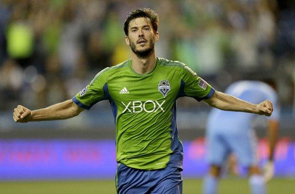 Brad Evans, celebrating after scoring a goal for the Sounders last month, has been hobbled by a strained calf.