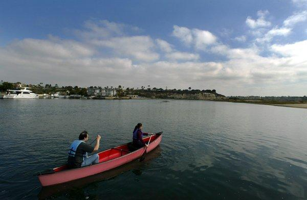 A file photo shows canoeists paddling in the Upper Newport Bay.