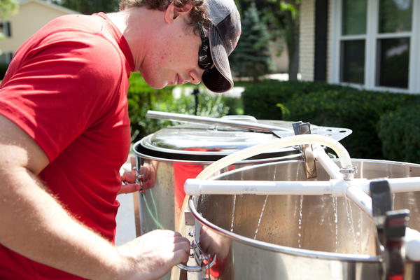 Brewer Tom Korder of Penrose Brewing Company in Geneva, Ill., checks the progress of his sparge during a recent home brew session.