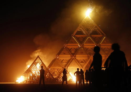 The Temple of Whollyness is burned during the Burning Man 2013 arts and music festival in the Black Rock Desert of Nevada.