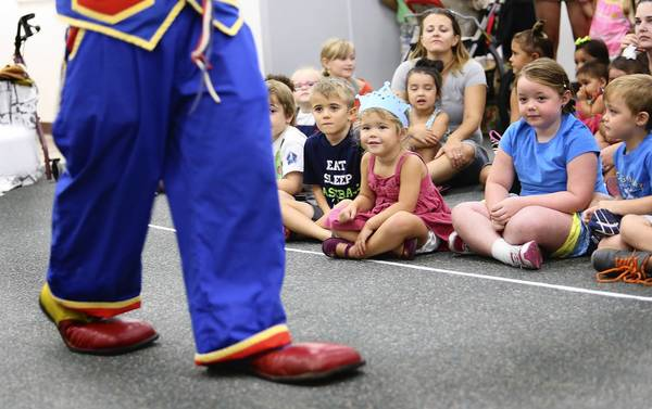 Children enjoyed a magic show and other clown antics on Friday August 9, 2013, in Mount Dora. The W.T. Bland Public Library in Mount Dora celebrated International Clown Week with daily events featuring Lake county clowns, history of clowns , clown shoe making and a clown magic show. (Tom Benitez/Orlando Sentinel)