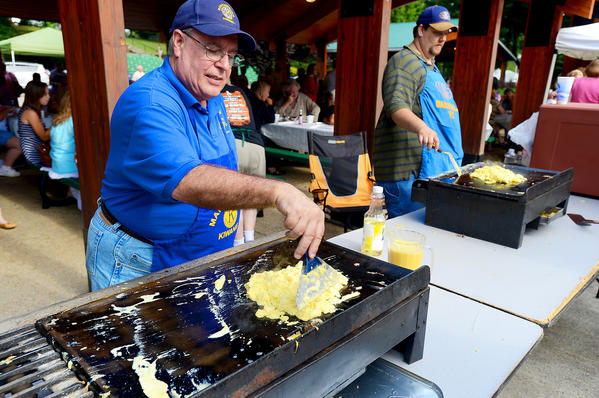 Jack Lauer, left, and Joseph Peyton, members of the Martinsburg (W.Va.) Kiwanis Club, are busy Monday morning making eggs for the hundreds of people attending the annual Labor Day breakfast at War Memorial Park in Martinsburg.