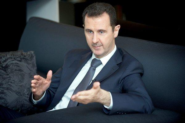 An image released by the Syrian Arab News Agency shows Syrian President Bashar Assad speaking during an interview with French newspaper Le Figaro in Damascus, Syria.