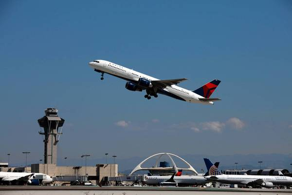 U.S. airlines have strongly opposed a European law that levies a fee on greenhouse gas emissions for flights originating or ending in Europe. The U.S. carriers say it violates international law and penalizes longer routes that non-European airlines fly. Above, arcraft take off and land at Los Angeles International Airport.