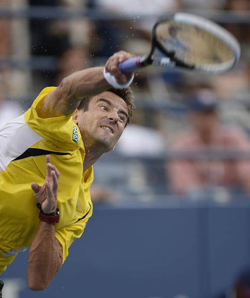 Tommy Robredo of Spain serves to Roger Federer of Switzerland during their match on the eighth day of the 2013 US Open Tennis Championship.