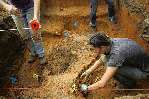 A grave is exhumed at the Arthur G. Dozier School for Boys in Marianna, Fla., where dozens are believed to have died over the years.