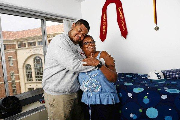 Neighborhood Academic Initiative scholarship recipient Tristan Baizar hugs his mother, Malva Yorke, in his new dorm room.