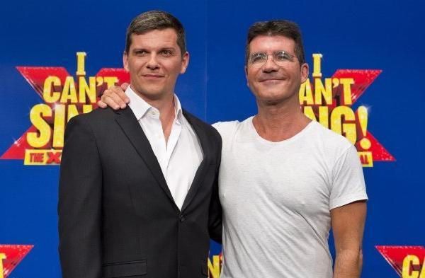 "Nigel Harman, left, and Simon Cowell at the London launch of ""I Can't Sing! The X Factor Musical"""