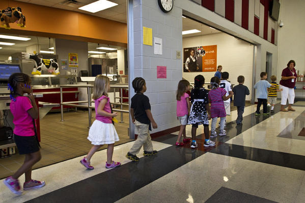 First day back to school at Phenix Pre-K-8 school in Hampton. Kindergarten Teacher Darlene North leads her class in and around their lunch area of the school during the tour.