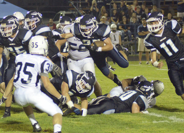 Petoskey junior running back Kurt Boucher (middle) leaps over a pair of teammates during Friday's season-opener against Sault Ste. Marie Friday at Curtis Field. The Northmen defeated the Blue Devils, 23-7.