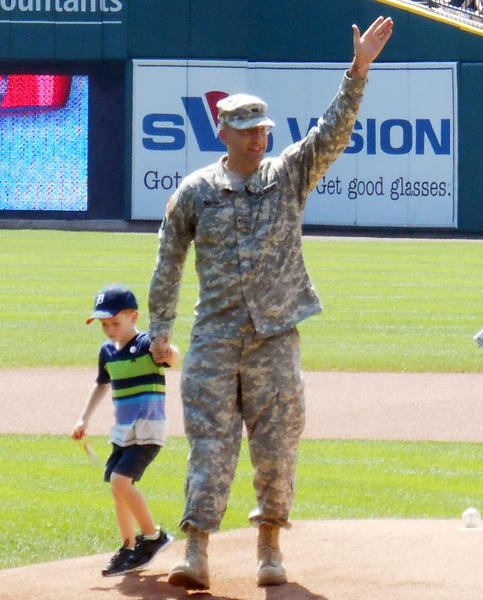 United States Army Sergeant First Class Matthew Mayer of Petoskey along with son Trevyn (left) delivered the game ball to the mound Thursday, Aug. 29, at Comerica Park prior to the Detroit Tigers game against the Oakland Athletics.
