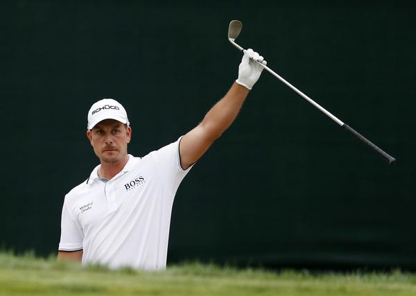 Henrik Stenson celebrates after making birdie from the bunker on the 17th green during the final round of the Deutsche Bank Championship in Norton, Mass., on Monday.