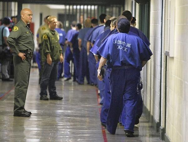 Inmates are watched by members of the Los Angeles County Sheriff's Department at the Men's Central Jail in Los Angeles.