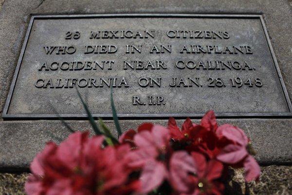 Grave marker for Mexican nationals killed in 1948 plane crash.