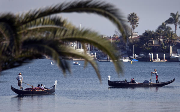 Two couples take a gondola cruise through Newport Harbor.