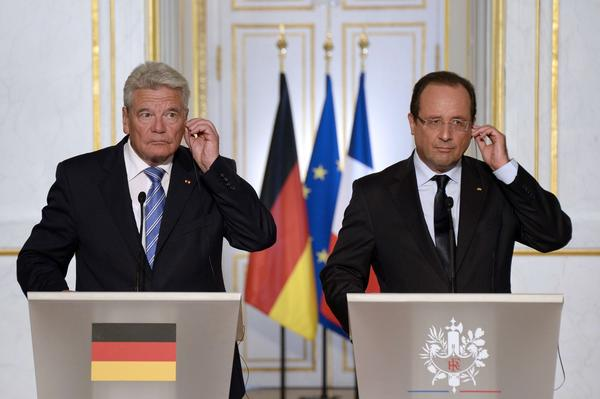 French President Francois Hollande, right, and his German counterpart Joachim Gauck give a joint news conference after a meeting at the Elysee Palace in Paris.