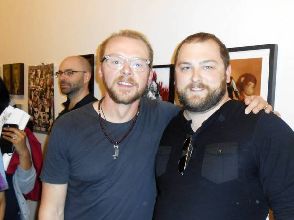 "Plainfield artist Ashton Gallagher created two original works for a California art show dedicated to the work of British director Edgar Wright. At the premier he got to meet Simon Pegg, left, a star of Wright's films who also plays Scottie in the new ""Star Trek"" movies."