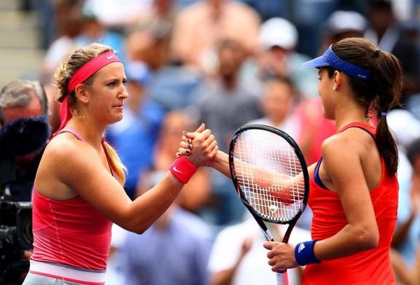 Victoria Azarenka, left, and Ana Ivanovic meet at the net after their match.