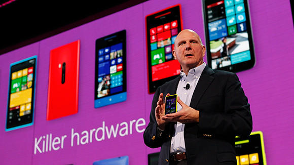 Microsoft Corp CEO Steve Ballmer displays a Nokia Lumia 920 featuring Windows Phone 8 during an event in San Francisco in this 2012 file photo. Two years after hitching its fate to Microsoft's Windows Phone software, Nokia collapsed into the arms of the U.S. software giant on Tuesday, agreeing to sell its main handset business for $7.2 billion.