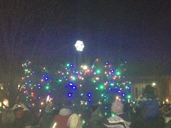 "For last year's downtown Christmas Tree lighting, people gathered around a storm-slashed spruce that organizers dubbed the ""Charlie Brown Tree."""