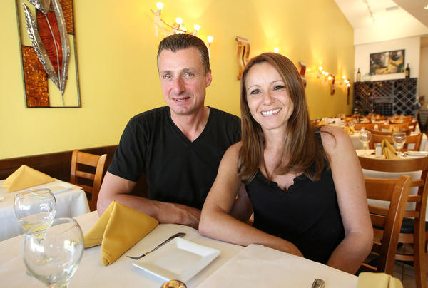 Cafe Sole owner and chef Salvatore Attanasio and wife Alessandra pose for a portrait in the dining area of the La Cañada trattoria on Thursday, August 29, 2013.