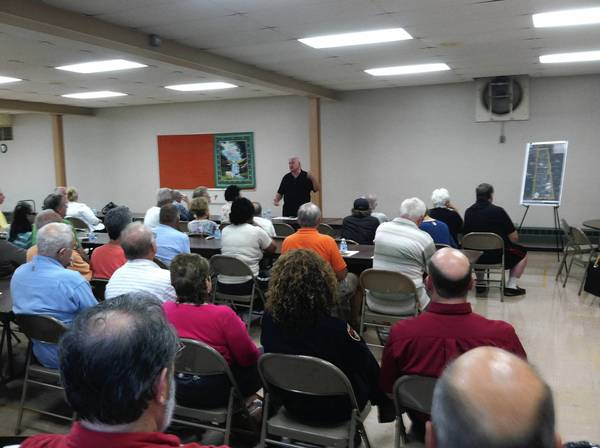 Des Plaines Ald. James Brookman, 5th, talks to residents at an Aug. 29 ward meeting about improving the Apache Park area.