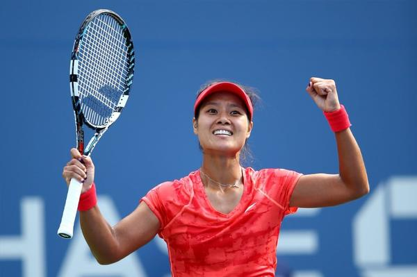Li Na reacts after advancing to the U.S. Open semifinals.