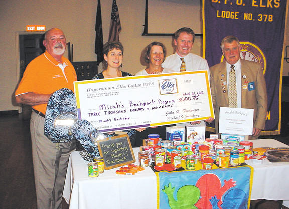 From left, Frank Clopper, Elks National Foundation chairman; Kathy Powderly, Micahs Backpack program; Carol Brashears, Micahs Backpack program, Matt Thompson, Maryland Food Bank; and G. Scott Davis, Elks 378 exalted ruler, during a check presentation.