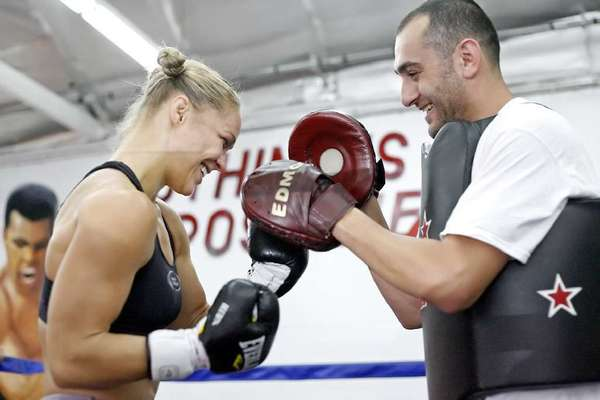 "ARCHIVE PHOTO: Edmond Tarverdyan, right, says Ronda Rousey, who trains at the Glendale Fighting Club, is reportedly very motivated and happy while training on location in Bulgaria for the filming of the ""The Expendables 3."""