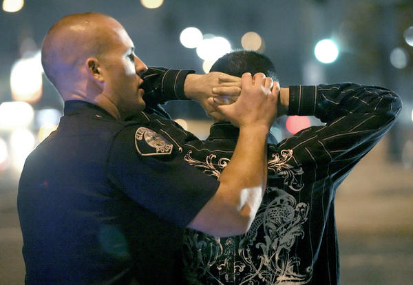 File Photo: Glendale police officer Kyle Heinbechner searches a car occupant at a DUI checkpoint on Los Feliz Blvd. at San Fernando Rd. on Friday, January 2, 2009. Seven motorists were arrested Saturday, August 31, 2013 during saturation patrols focused on drunk driving in Glendale.