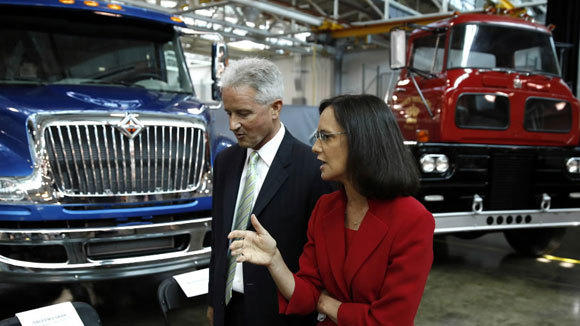 Illinois Attorney General Lisa Madigan and Navistar Vice President Denny Mooney tour the company's Test and Development Center in Melrose Park in July.