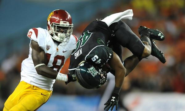 Hawaii's Donnie King Jr. is upended in front of USC safety Dion Bailey during the Trojans' win on Thursday. Bailey likely will see plenty of action Saturday against pass-happy Washington State.