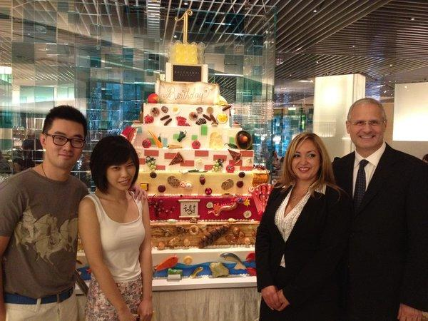 Tianshu Sun, second from left, the millionth guest at Bacchanal Buffet, is joined by her companion Yao Cheng, buffet general manager Gabrielle Perez and Caesars Palace President Gary Selesner in front of a giant cake marking the buffet's first birthday.