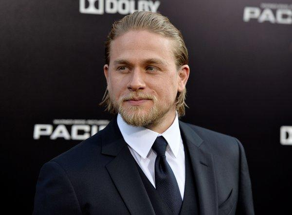 "Actor Charlie Hunnam, shown arriving at the premiere of ""Pacific Rim,"" has been cast as Christian Grey in the upcoming film ""Fifty Shades of Grey."" His casting is being protested by some fans of the racy novel."