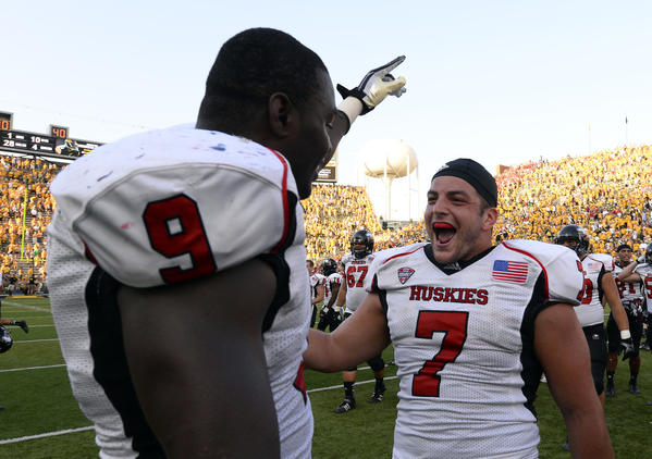 Huskies linebacker Rasheen Lemon (9) and linebacker Michael Santacaterina (7) celebrate the win over Iowa.