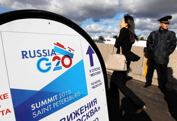 With Russian President Vladimir Putin, a chief Syria ally, serving as host of this year's G-20, there may be a chill in the halls of the 18th-century Constantine Palace, the summit site. Above, a banner for the summit by the Neva River in St. Petersburg.