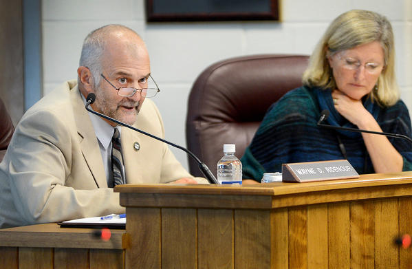 Washington County Board of Education member Wayne Ridenour, left, spoke about the self-evaluation policy Tuesday afternoon at the board auditorium. At right is board member Donna Brightman.