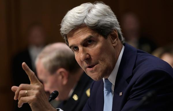 Secretary of State John Kerry answers a question from Sen. Rand Paul while testifying before the Senate Foreign Relations Committee on Tuesday on authorizing the use of force against Syria.
