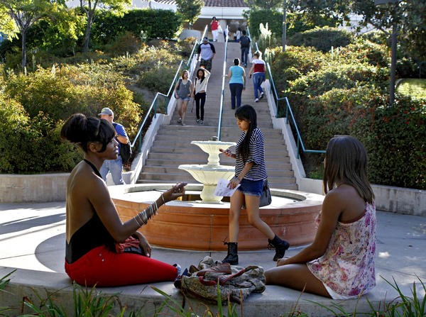 Nandi Watson, 20, of Pasadena, left, and Justice Nicole, 20, of Burbank, take a break before heading off to the first day of fall classes at Glendale Community College on Tuesday, September 3, 2013.