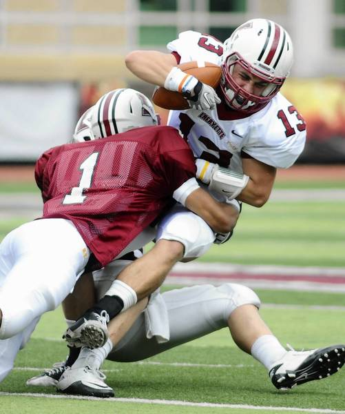Lafayette's Justin Adams (13) is stopped by Jared Roberts during the Maroon and White game at Fisher Field in April.