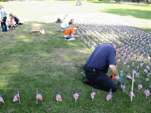 Each year volunteers gather Sept. 10 around 4:30 p.m. to plant flags on Winnetka's Village Green in honor of the victims of the Sept. 11, 2001, terrorist attacks.