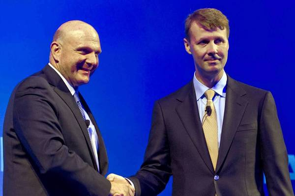 Microsoft CEO Steve Ballmer, left, shakes hands with Risto Siilasmaa, Nokia's chairman, during a news conference in Espoo, Finland, announcing Microsoft's acquisition of Nokia's mobile phone business in a $7.2 billion deal.