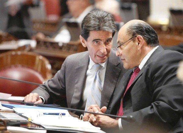 State Sen. Mark Leno (D-San Francisco), left, talks with Sen. Lou Correa (D-Anaheim) at the Capitol in Sacramento.