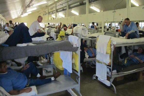 Inmates housed in the dormitory at California Institution for Men in Chino show crowded conditions.